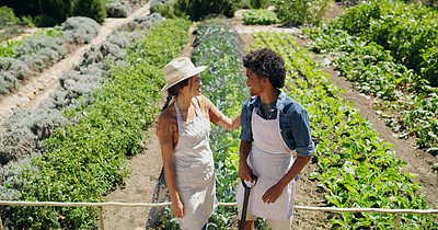 Buy stock photo High angle shot of an affectionate young couple standing in the fields on their farm