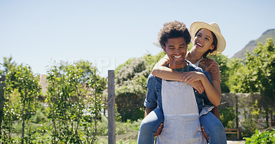 Buy stock photo Cropped portrait of a handsome young male farmer piggybacking his wife while working on their farm