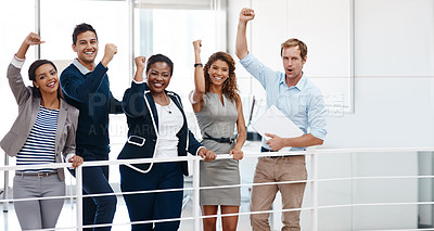Buy stock photo Cropped shot of a diverse group of colleagues celebrating success with their arm raised at the office