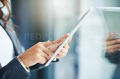 Buy stock photo Cropped shot of a businesswoman using a digital tablet in a modern office
