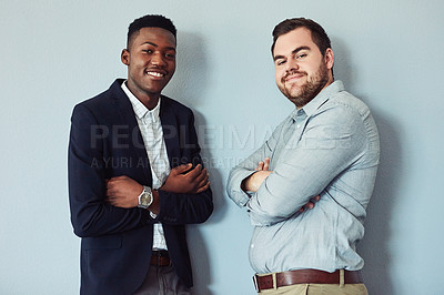 Buy stock photo Studio portrait of two confident young businessmen standing together against a grey background