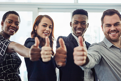 Buy stock photo Portrait of a group of young businesspeople giving thumbs up in a modern office