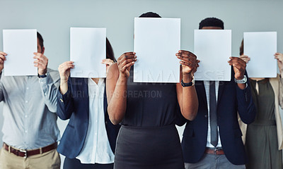 Buy stock photo Studio shot of a group of businesspeople holding blank signs in front of their faces