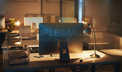 Buy stock photo Shot of an empty office area in a building during the evening