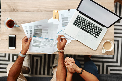 Buy stock photo Cropped high angle shot of a couple going over their finances together at home