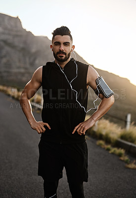 Buy stock photo Portrait of a sporty young man exercising outdoors