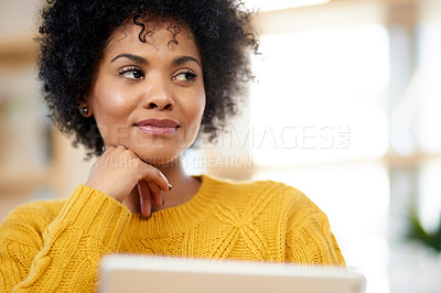 Buy stock photo Cropped shot of a young woman using a digital tablet