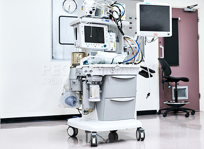 Buy stock photo Cropped shot of hospital machines being stored in an empty room in a modern hospital