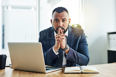 Buy stock photo Portrait of a determined businessman sitting at his desk