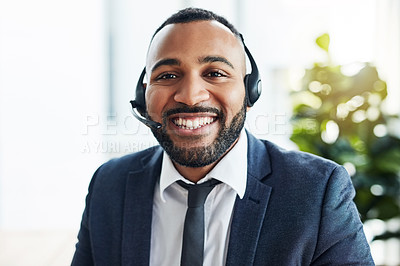 Buy stock photo Portrait of a sales agent sitting at his desk with his headset on