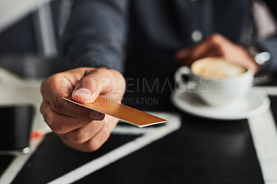 Buy stock photo Cropped shot of an unrecognizable man offering his card to pay for his coffee
