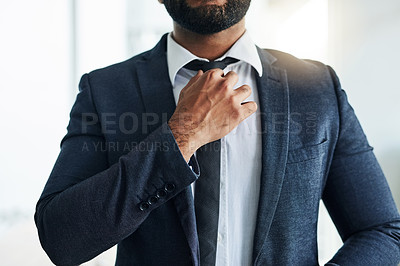 Buy stock photo Cropped shot of an unrecognizable businessman adjust his tie