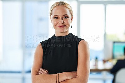 Buy stock photo Portrait of a beautiful young businesswoman in an office