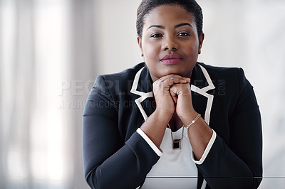 Buy stock photo Cropped portrait of an attractive young businesswoman sitting behind her desk in the office