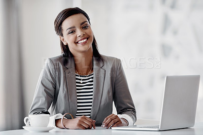 Buy stock photo Cropped portrait of an attractive young businesswoman using her laptop while working in the office