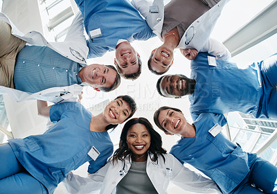 Buy stock photo Cropped shot of a group of healthcare workers looking down at the camera