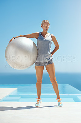 Buy stock photo Full length portrait of an attractive young woman holding an exercise ball by the pool after her workout