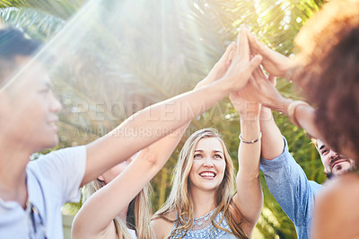 Buy stock photo Cropped shot of a group of cheerful friends giving out high fives to each other outside in the afternoon