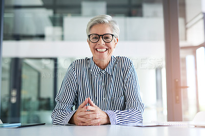 Buy stock photo Portrait of an attractive mature businesswoman sitting at her office desk at work