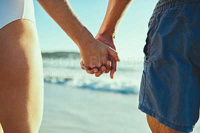 Buy stock photo Closeup shot of a couple holding hands at the beach