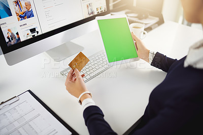 Buy stock photo Shot of an unrecognizable young businesswoman holding a bank card and a tablet in a modern office