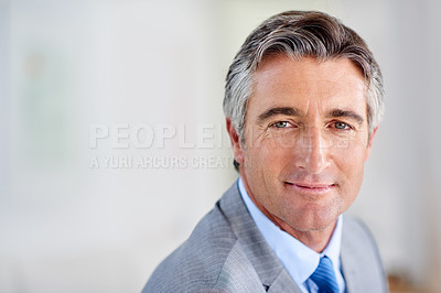 Buy stock photo Headshot of a confident mature businessman smiling and wearing a suit indoors