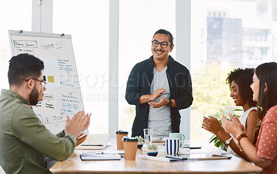 Buy stock photo Shot of a group young businesspeople clapping during a presentation in a modern office