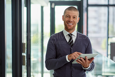 Buy stock photo Portrait of a handsome middle aged  businessman working on a digital tablet in his office