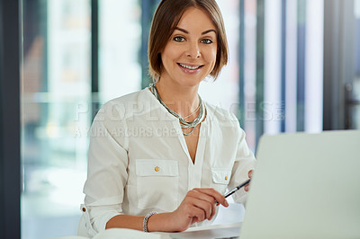 Buy stock photo Portrait of an attractive young  businesswoman working on a laptop in her office