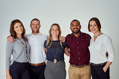 Buy stock photo Studio portrait of a group of cheerful young work colleagues standing together against a white background