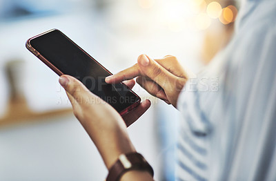 Buy stock photo Shot of an urecognizable businesswoman using a cellphone in her office at work
