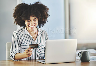 Buy stock photo Shot of an attractive young businesswoman using a digital tablet and laptop in her office at work