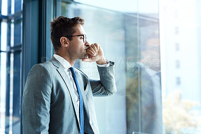 Buy stock photo Cropped shot of a professional businessman looking thoughtful while standing in his office
