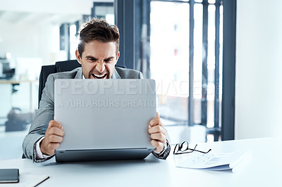 Buy stock photo Cropped shot of a businessman looking irritated with his laptop