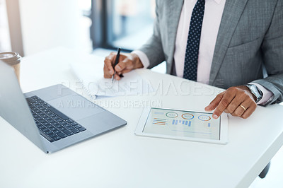 Buy stock photo Cropped shot of an unrecognizable businessman using a digital tablet