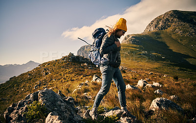 Buy stock photo Shot of a beautiful young woman out mountain climbing