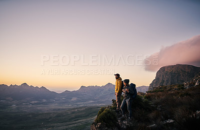 Buy stock photo Shot of a young couple out mountain climbing together