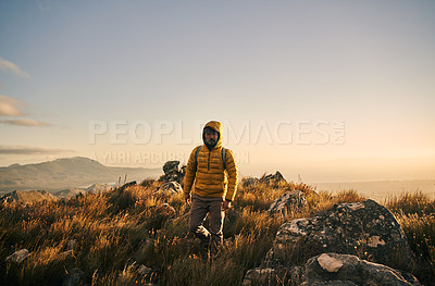 Buy stock photo Shot of a handsome middle aged man out mountain climbing