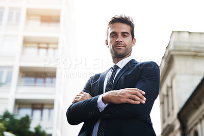 Buy stock photo Portrait of a handsome young businessman on his morning commute to work