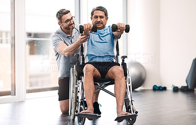 Buy stock photo Full length shot of a senior man in a wheelchair exercising with dumbbells along side his physiotherapist