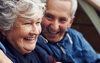 Buy stock photo Cropped shot of an affectionate senior couple relaxing on their chosen camping spot