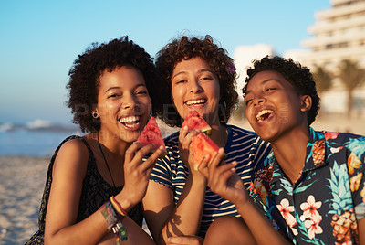 Buy stock photo Portrait of three attractive young women eating watermelon pieces on the beach during the day