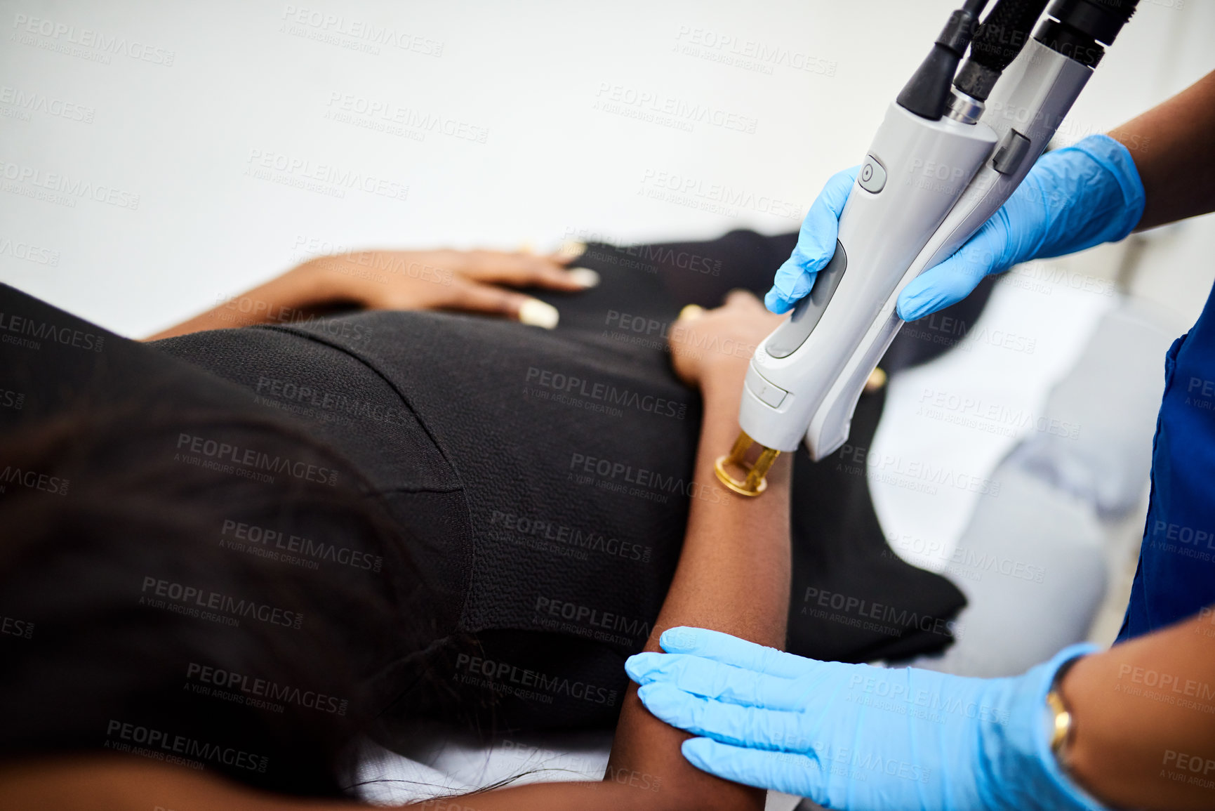 Buy stock photo Shot of an unrecognizable woman getting laser treatment on her arm at a beauty clinic