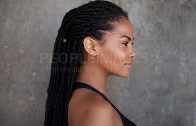 Buy stock photo Shot of an attractive young sportswoman posing against a wall outdoors