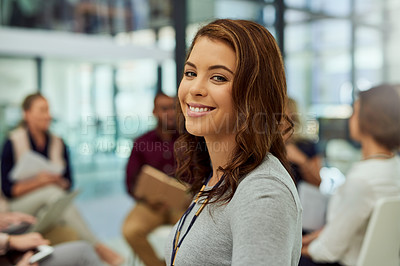 Buy stock photo Portrait of an attractive young businesswoman at an office meeting with her colleagues in the background