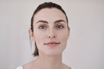 Buy stock photo Portrait of an attractive young woman going through her morning beauty routine at home