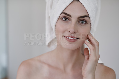 Buy stock photo Portrait of a beautiful young woman feeling her skin during her beauty routine at home