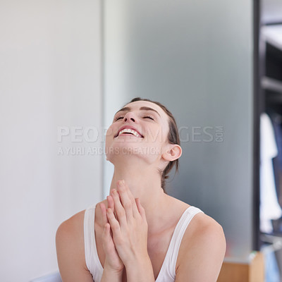 Buy stock photo Shot of an attractive and happy young woman going through her morning beauty routine at home