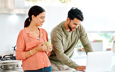 Buy stock photo Cropped shot of a young couple looking at something on a laptop