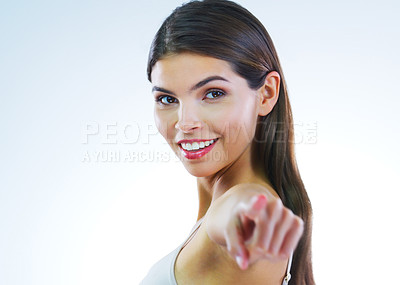 Buy stock photo Cropped shot of a beautiful young woman posing against a white background
